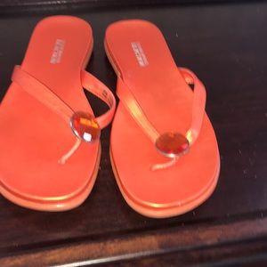 orange flip flops with a gem